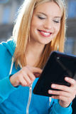 Woman using digital tablet outdoors Royalty Free Stock Photos