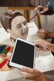 Woman using digital tablet while painting a sculptor. In drawing class Royalty Free Stock Images