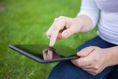 Woman using digital tablet PC Royalty Free Stock Photography