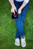 Woman using digital tablet PC Royalty Free Stock Image