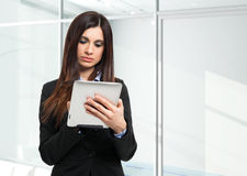 Woman using a digital tablet Royalty Free Stock Image