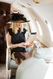 Woman Using Digital Tablet In Private Jet Royalty Free Stock Photography