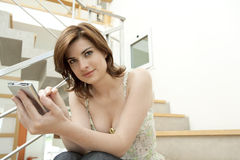 Woman Using a Digital Tablet in Staircase Royalty Free Stock Photos