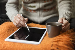 Woman Using Digital Tablet With Touch Pen Stock Photo