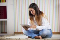 Woman using a digital tablet Stock Photos