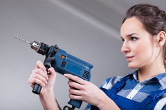 Woman using a drill Royalty Free Stock Image