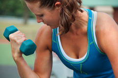 Woman Using Dumbbell Outdoors Royalty Free Stock Images