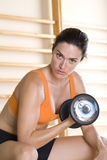 Woman using dumbbell, portrait, close-up Royalty Free Stock Image