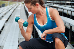 Woman Using Dumbbell on Stadium Bleachers Stock Photos