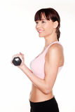 Woman Using Dumbbells Royalty Free Stock Photography