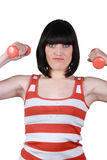 Woman using dumbbells Royalty Free Stock Images