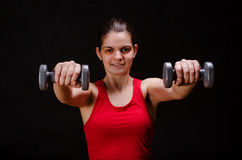 Woman using dumbbells Stock Images
