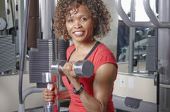 Woman using dumbells Royalty Free Stock Photography