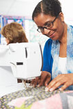 Woman Using Electric Sewing Machine Stock Photos