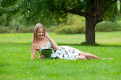 Woman using electronic tablet Royalty Free Stock Photos