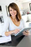 Woman using electronic tablet Royalty Free Stock Image