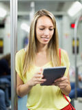 Woman using ereader in subway Royalty Free Stock Photography