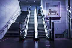 Woman Using an Escalator in a Subway Alone Stock Photography