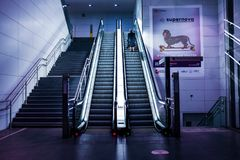 Woman Using an Escalator in a Subway Alone Royalty Free Stock Images