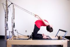 Woman Using Exercise Equipment royalty free stock photography