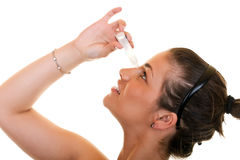 Woman using eye drops Royalty Free Stock Photography