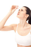 Woman using eye drops Stock Photos