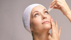 Woman using eye drops. Medicine treatment. Eyecare human problem. Ophtalmology dropper royalty free stock photos