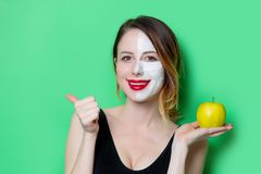 Woman using eye patch for her eyes and mask with apple Stock Photos
