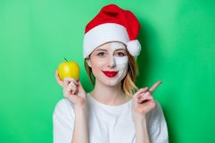 Woman using eye patch for her eyes in Santa Claus hat Royalty Free Stock Photo