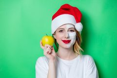 Woman using eye patch for her eyes in Santa Claus hat Stock Photos