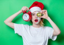 Woman using eye patch for her eyes in Santa Claus hat Royalty Free Stock Image