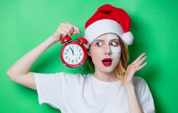 Woman using eye patch for her eyes in Santa Claus hat Royalty Free Stock Photography