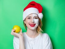 Woman using eye patch for her eyes in Santa Claus hat Stock Image