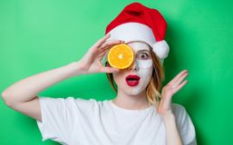 Woman using eye patch for her eyes in Santa Claus hat Stock Images