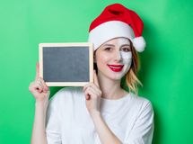 Woman using eye patch for her eyes in Santa Claus hat Royalty Free Stock Photos