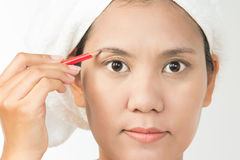 Woman using eyebrows pencil Royalty Free Stock Photography