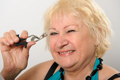 Woman using eyelash curler. Stock Image