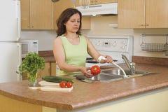Woman Using Faucet Stock Photos