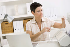 Woman using fax machine Royalty Free Stock Photos