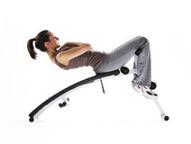 Woman using fitness machinery Stock Images