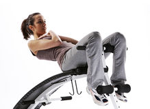 Woman using fitness machinery Royalty Free Stock Image