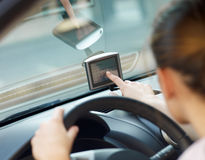 Woman using global positioning system Stock Photography