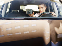 Woman using global positioning system Stock Images