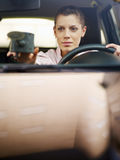 Woman using global positioning system Royalty Free Stock Photography