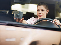Woman using global positioning system Stock Photo