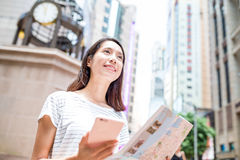 Woman using gps and city map to find the location in Hong Kong Stock Images