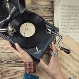 Woman using gramophone. Woman hands touching to the retro gramophone. Cherished memories Rare music things. Toned tinted filtered square photo instagram retro Stock Image
