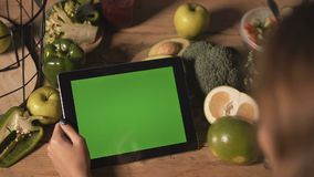Woman uses tablet stock video