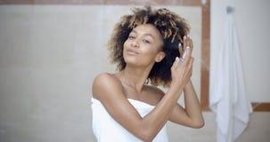 Woman Using Hair Spray In Bathroom Royalty Free Stock Photo