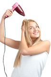 Woman using hairdryer Stock Image